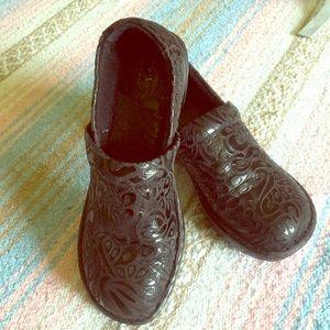 BOC embossed black leather clogs